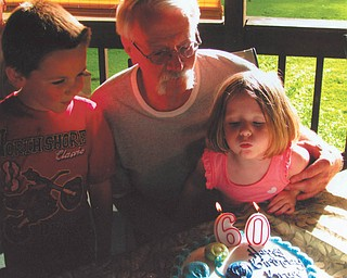Grandpa Bruce Geilhard of Vienna celebrates his 60th birthday in June with grandchildren Logan and Sara Geilhard of Mecca.