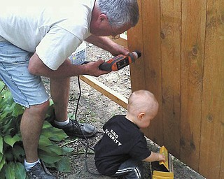 Ron Diefenderfer of Austintown receives help from grandson Evan Diefenderfer of Canfield. Photo was submitted by Trish Diefenderfer.