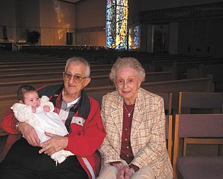 Thomas and Anne Mirante Jr. of Cornersburg attend the baptism of their first and only grandchild, Trinity Mirante, also of Cornersburg. Photo was submitted by their daughter-in-law, Valerie Mirante.