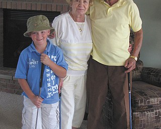Jonathon Vaschak of Boardman poses with his really awesome grandparents, Joseph and Sylvia Vaschak of Campbell. When Jonathon expressed interest in playing golf with his grandparents, Grammy and Papa gave him a set of clubs for his birthday. Not only does he get to spend time with them, but he has great teachers too! He adores them!
