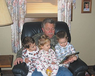Papa Dedo is shown with three of his six grandchildren, Alan, Sophia and Ross.