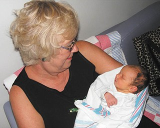 Holding her brand-new granddaughter, Leah Lynn Kovacs, is Lynne Challenger Kovacs, both of Youngstown.