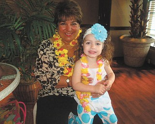 Best pals Ava Valentina Acevedo, 2 1/2, and NaNa Paula Shields, both of Boardman, are enjoying a luau celebration. Ava is the daughter of Toni and Rob Acevedo.