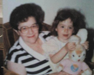 This is a picture of Tara Fisher as a little girl with her grandma, Hazel O'Hara.