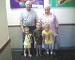 Bill and Mary Lou Kerr are with their grandson, Timmy Kerr, and great-grandkids, Zane and Addison Householder.