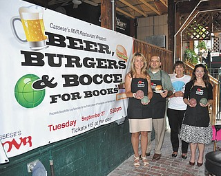 """Lindsay Y. McCall   The Vindicator: Joe Cassese of Cassese's MVR was on hand recently with co-chairwomen, from left, Debbie Liptak, library development director, Julie Costas and Natalie Lariccia to begin planning the Sept. 27 """"Beer, Burgers and Bocce for Books, Chapter 11"""" fundraiser to benefit the Public Library of Youngstown and Mahoning County."""