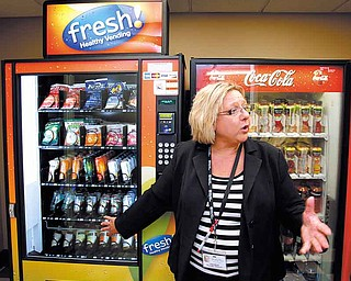 Certified dietary manager Sandy Milan talked about choices available in a vending machine in Kansas City, Missouri, on August 3, 2011. (Keith Myers/Kansas City Star/MCT).r