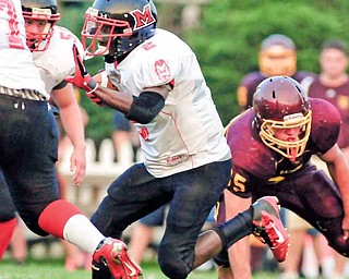 Campbell running back Ja'les Hughes (2) breaks away from South Range defenders for a gain in Friday's game during Week 2 of the 2011 prep football season at South Range High School in Beaver Township. The Red Devils dominated the Raiders, 41-20.