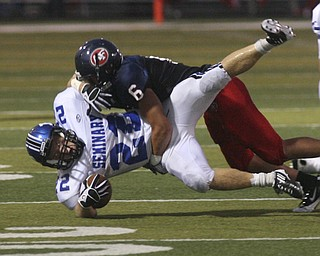 ROBERT  K.  YOSAY  | THE VINDICATOR --..Putttin him down is Fitchs #6 Lucas Haupt  puts a stop on #22 Polands Jerry Lawman -..Poland Bulldogs at Fitch Falcons Friday Night Game.--30-..(AP Photo/The Vindicator, Robert K. Yosay)