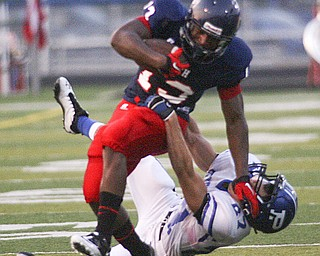 ROBERT  K.  YOSAY  | THE VINDICATOR --..Polands #27 Jordan Smith Takes a stiff arm from Fitchs #13  Will Mahone during first quarter action as Mahone made the first and 10..Poland Bulldogs at Fitch Falcons Friday Night Game.--30-..(AP Photo/The Vindicator, Robert K. Yosay)