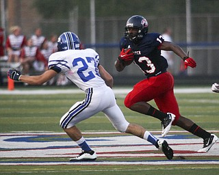 ROBERT  K.  YOSAY  | THE VINDICATOR --..Polands #27 Jordan Smith zeros in on Fitchs #13  Will Mahone during first quarter action as Mahone made the first and 10Poland Bulldogs at Fitch Falcons Friday Night Game.--30-..(AP Photo/The Vindicator, Robert K. Yosay)