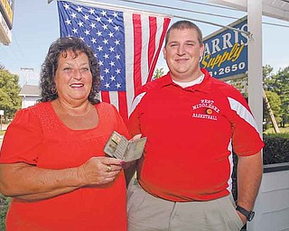 """Virginia L. and Jerald A. Barris of West Middlesex, Pa., hold a silver cigarette case that was carried by their ancestor, Army doughboy Willis William """"Bill"""" Barris in France during World War I. The cigarette case was found in an old metal lockbox passed down through generations of Barris men to Jerald A."""