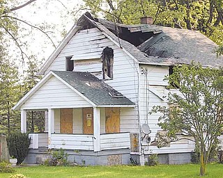 JESSICA M. KANALAS | THE VINDICATOR.3397 Pothour Wheeler Road --Hubbard township home burned two years ago. The township listed 22 properties to demolish. These properties have been foreclosed on and now held by banks, but the banks donÕt want to take care of them... -30-