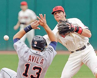Cleveland Indians second baseman Jason Donald, right, throws over Detroit Tigers' Alex Avila (13) but can't complete a double play on Tigers' Jhonny Peralta in the fourth inning of a baseball game Monday, Sept. 5, 2011, in Cleveland. (AP Photo/Mark Duncan)