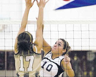 Fitch's Sam Koniowsky (10) sends the volleyball past Warren Harding's Christina Bland (17) during Tuesday's match at Fitch High. The Falcons swept the Raiders.