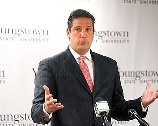 U.S. Rep. Tim Ryan, D-17th, of Niles explains why the new solar panel system also benefitted local companies, who supplied some of the materials. Ryan spoke Tuesday as Youngstown State University unveiled the system.