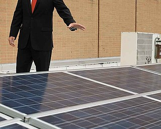 Youngstown State University Engineer Ralph Morrone shows a new solar-panel system on the roof of Moser Hall. YSU officials said Tuesday the system will provide part of the energy needs for the building, saving the university $160,000 over the system's 25-year life span.
