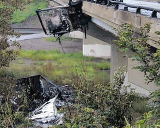 A tractor-trailer accident Wednesday morning sent a portion of the semi over the bridge on Interstate 80 over Mount Everett Road in Hubbard Township. Fire and hazardous-materials crews worked for more than 12 hours to clear the scene, and a portion of I-80 was closed for most of the day.