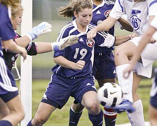 William DLewis  The Vindicator Fitch's Lauren Bower #19 , left, and Poland's Maura Bobby go for the ball during Wed action at Poland.