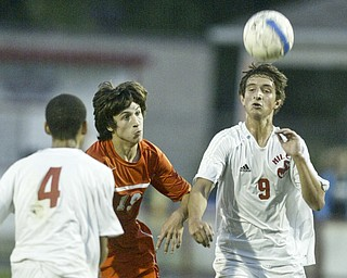 William d Lewis The Vindicator Keir MacMillan of Niles heads the ball while team mate Octavius Smith and Howland's Alex Tvaroch look on during Thursday action at Niles.
