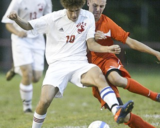 William d Lewis The Vindicator NilesCJ Cicero, left, and  Connor Gilmour, left, and Kyle Watson of Howland go for the ball during Thursday action at Niles.