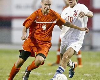 William d Lewis The Vindicator Howland's Kyle Watson, left, and CJ Cicero of Niles go for the ball during Thursday action at Niles.