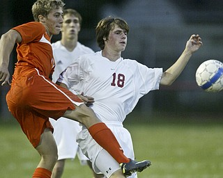 William d Lewis The Vindicator Howland's Connor Sherin, left, and Tyler Hinton of Niles go for the ball during Thursday action at Niles.