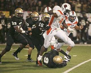 ROBERT  K.  YOSAY  | THE VINDICATOR --..Howlands #4 Deveon Smith  hurdles Warrens #9  Lebrandon Watson as he runs for a first down  in third quarter action -  behind him is Howlands#40 Brandon Miller and Warrens  15-Jal-lyn Moore 22 Kyle Cogley and 33 Audraanez cambridgeHowland Tigers vs Warren G Harding Raiders @ Warren ..--30-..(AP Photo/The Vindicator, Robert K. Yosay)