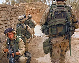 Vindicator staff writer Robert Guttersohn, facing the camera, during the invasion of Iraq in 2003 in the city of As Samawah. Guttersohn, who enlisted in the Army in 2002, said the 9/11 attacks and his three tours in Iraq changed his outlook on life.