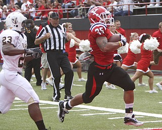 ROBERT K. YOSAY | THE VINDICATOR..YSU Jamaine Cook scampers 31 yards for a TD  and pushing the score to 21points as Valpo #23 John Edwards can only watch - Jamaine had 126 yards and  2 TD..-30