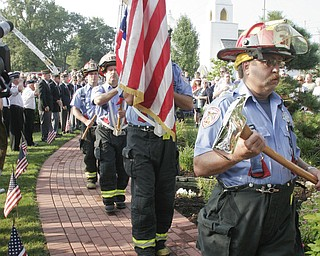 William D. Lewis | The Vindicator Austintown Fire Fighter Honor Guard posts colors during a Sunday observance of the 9/11 attacks at the Austintown 9/11 Memorial Park. Hundreds of area residents and representatives from many fire departments where on hand for the event.
