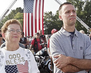 William D. Lewis | The Vindicator Linda Alexander of Austintown and Jeff Mills of Canfield during a Sunday observance of the 9/11 attacks at the Austintown 9/11 Memorial Park. Hundreds of area residents and representatives from many fire departments were on hand for the event.