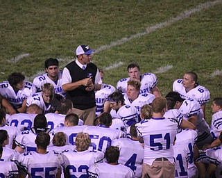 Attached is a picture of Coach Mark Brungard talking to his Poland Bulldogs after a hard fought battle versus the Hubbard Eagles on Opening Night, August 25, 2011. Coach was sporting a sweater vest and tie in honor of his former coach and mentor, Jim Tressel. Brungard was the quarterback who helped lead Tressel's YSU Penguins to National Titles in 1993 and 1994.