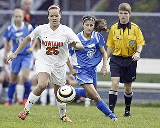 William D. Lewis  The Vindicator Howland's Jenna dorchock goes for the ball during 9-14-11 game with Poland at Howland.