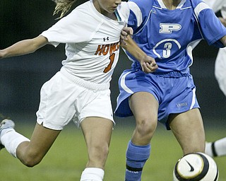 William D. Lewis  The Vindicator Howland's Jordan Entler and Poland's Channy Conzett during 9-14-11 game at Howland.