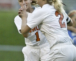 William D. Lewis  The Vindicator  Howland's Olivia Nicholas, RIGHT #2 gets congrats from Joedan entler after scoring the first goal of the game Wed against Poland.