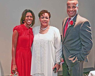 The Williamses pose for a photo with Jaladah Aslam, president of the Youngstown Warren Black Caucus. The event is the organization's main fundraiser.