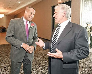 Youngstown's former mayor Jay Williams and Mayor Chuck Sammarone chat at Mr. Anthony's in Boardman. The Youngstown Warren Black Caucus hosted a dinner Friday to honor Williams.