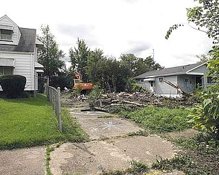 Rubble is all that remains of the house that once stood at 1029 Norwood Ave. on Youngstown's North Side. City crews demolished the dilapidated structure Friday after neighbors had complained about its deteriorating condition for years.