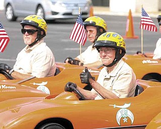 About 3,000 Shriners from six states and Canada traveled to Boardman on Friday and ran motorcycles and mini-Corvettes  in and out of orange cones in the former Value City parking lot. The Great Lakes Shrine Association Convention held in the Mahoning Valley this week.