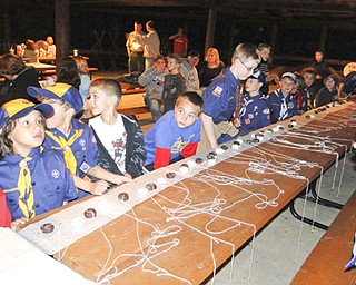 Members of Canfield Cub Scout Pack 25 and prospective Scouts competed in a doughnut-eating contest at last year's Roundup at Brown Pavilion at Camp Stambaugh. The Roundup takes place each year in September to enable interested boys to experience Scouting. This year's event will be Sept. 26.