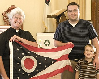 Ohio flag commemorates 9/11: To commemorate the 10th anniversary of the 9/11 terrorist attacks on New York; Washington, D.C.; and Pennsylvania, Columbiana County Recorder Craig Brown, right, presented an Ohio state flag to St. Paul's Lutheran Church of Leetonia. Accepting the flag for the church was the Rev. Kari Lankford. Brown was accompanied to the presentation by his son, Aaron Brown.