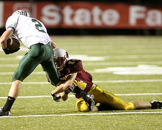 ROBERT  K.  YOSAY    THE VINDICATOR --..Strong arms Mooneys #14 Ryan Farragher stops Cougars  #2 Aaron Phillips after he caugt a short pass during second half action ---Youngstown Cardinal Mooney played Lake Catholic Cougars at Stambaugh Stadium..--30-..(AP Photo/The Vindicator, Robert K. Yosay)