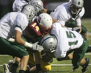 ROBERT  K.  YOSAY    THE VINDICATOR --..Mooneys #14 Ryan Farragher  is stopped at the line by Lakes #15  Zach Hawkins and a host of Cougars ---Youngstown Cardinal Mooney played Lake Catholic Cougars at Stambaugh Stadium..--30-..(AP Photo/The Vindicator, Robert K. Yosay)