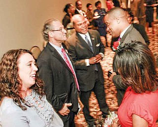 Michelle Hagan, left, and her husband, state Rep. Bob Hagan of Youngstown, D-60th district, greet Jay Williams and his wife, Sonja, before a dinner at Mr. Anthony's in Boardman. The Youngstown Warren Black Caucus hosted the dinner to honor Williams.
