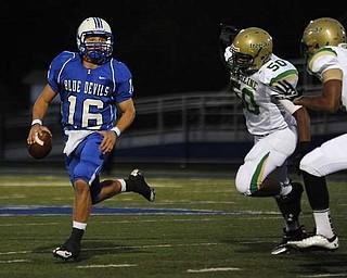Zainesville Quarterback Scrambles as Ursuline Defense was coming for him..