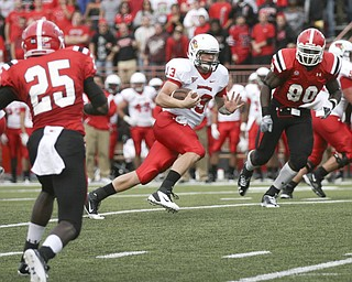 JESSICA M. KANALAS   THE VINDICATOR..Illinois State's quarterback Matt Brown rushes for 6 yards and is taken down by Youngstown State's safety Jeremey Edwards in the third quarter...-30