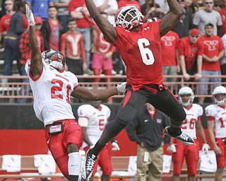 JESSICA M. KANALAS   THE VINDICATOR..Youngstown's wide receiver Jelani Berassa, 6, reaches for a pass from quarterback Kurt Hess in the second quarter of yesterday's game against Illinois State.  The Penguins beat the Redbirds 34-27...-30