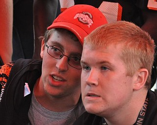 Students talk strategy during a Madden game during The Blitz Tailgate Party at Howland High School before the Canfield vs. Howland game on Friday, Sept. 16, 2011.