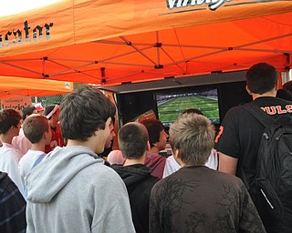 A team of students from both Howland and Canfield pre-game with a game of Madden 12 at the Blitz party on Friday, Sept. 16, 2011.